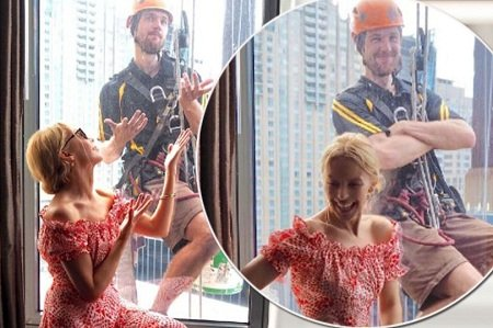 Image of MAIN Kylie Minogue gets photo bombed by a window cleaner