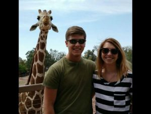 Image of couple and giraffe