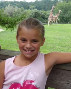 Image of kid and x rated giraffe