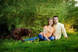 Image of couple and pooping dog