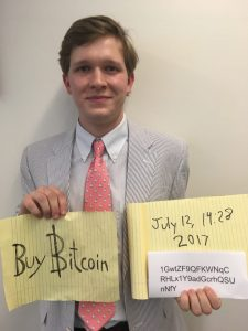 Image of bitcoin guy holds sign