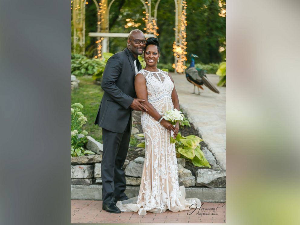 image of peacock photobomb a wedding in indiana couple