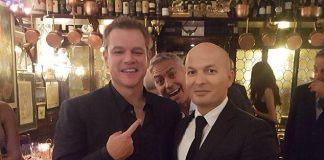 image of George Clooney Photobombing Matt Damon