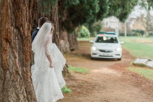 Image of Newly Weds and Police Car