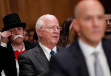 Image of Monopoly man attending US Senate Hearing